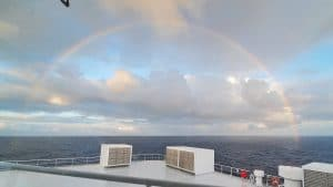 Picture from boat at sea of a rainbow