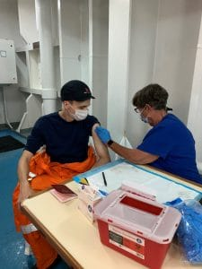 Crew of the Siem Plato being vaccinated